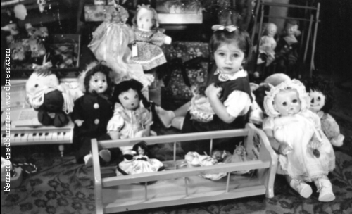Little girl with Christmas toys, about 1948